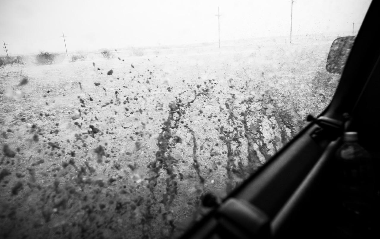 Water splashed against van's window as we pushed on wards.