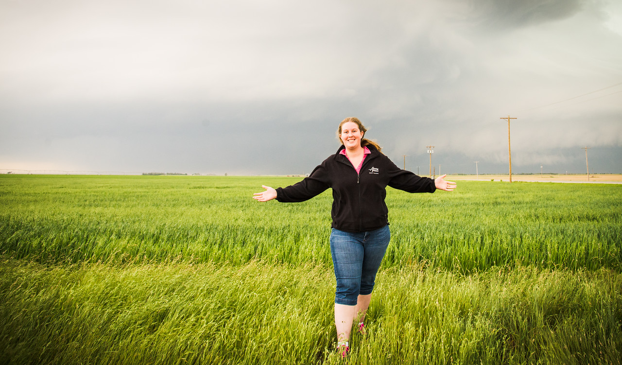 Emily posed in front of the storm.  A tornado was some where inside of the storm.