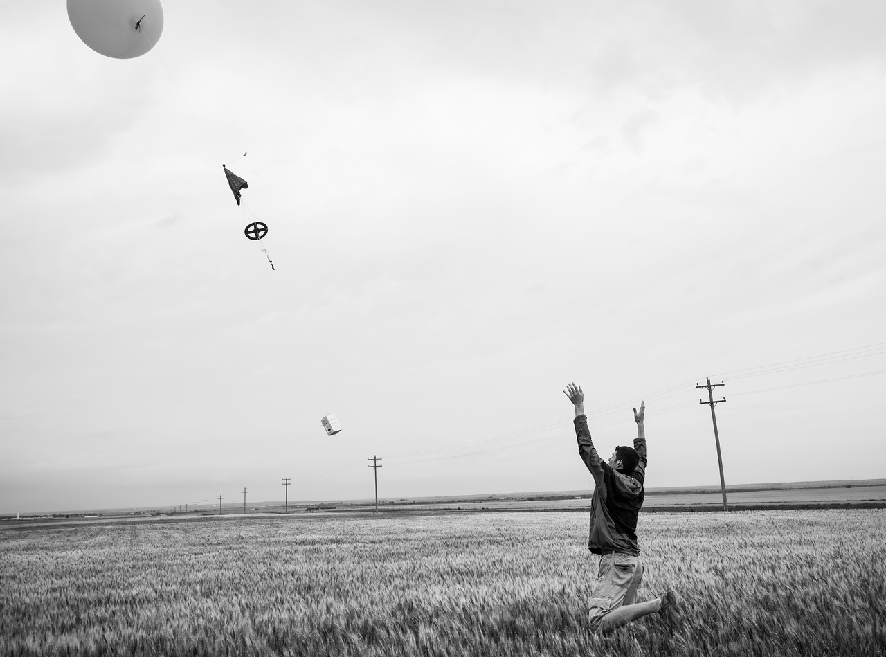 Launching a weather balloon, while waiting for the storm to initiate.  Too bad there wasn't enough Helium, and balloon was popped before reaching full height.