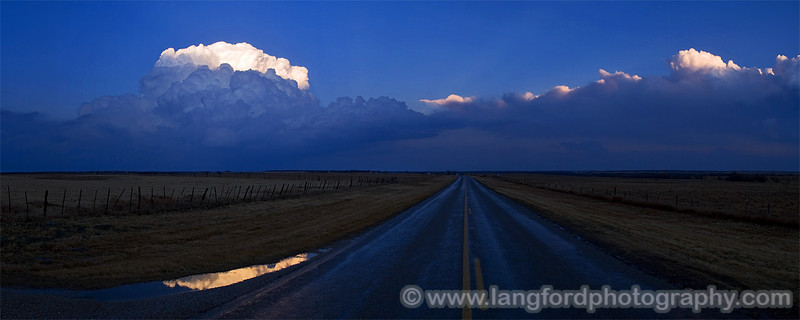 This was the view looking East towards Bowie.  The large storm to the left would later continue on into Oklahoma and strike Lone Grove. :(  The setting sun hitting the tops of the storms made for beautiful pictures.