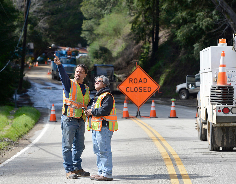 . Utility crews work near Fernwood where slides downed power poles Highway 1 in Big Sur on Wednesday February 22, 2017. (David Royal - Monterey Herald)