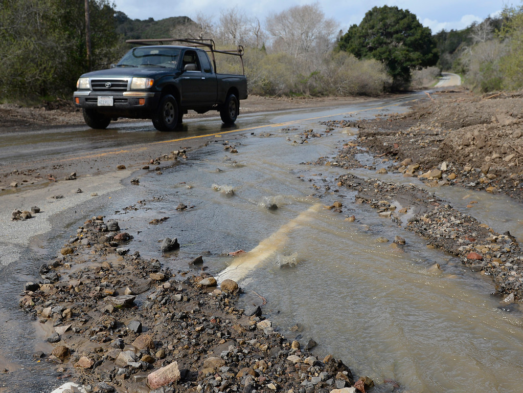 . A truck rolls past heavy flooding on Highway 1 south of Andrew Molera State Park in Big Sur on Wednesday February 22, 2017. (David Royal - Monterey Herald)