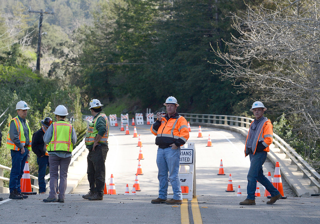 . The Pfeiffer Canyon Bridge sags behind Caltrans engineers as they evaluate storm damage on Highway 1 in Big Sur on Wednesday February 22, 2017. (David Royal - Monterey Herald)
