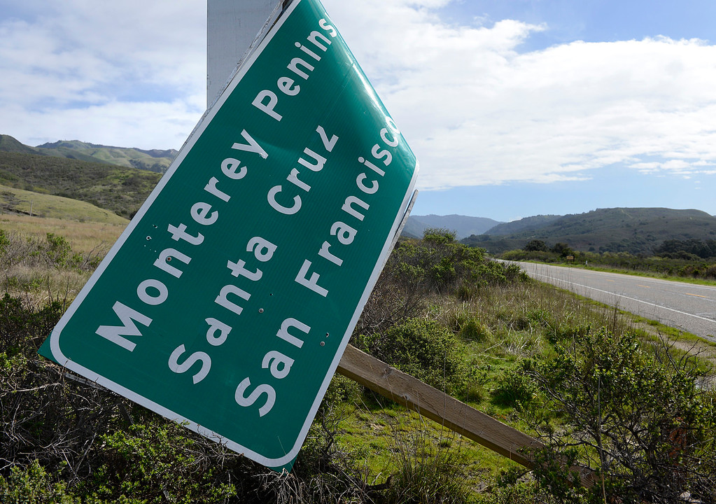. A sign on Highway 1 near Andrew Molera State Park shows damage from the storrm\'s powerful winds in Big Sur on Wednesday February 22, 2017. (David Royal - Monterey Herald)