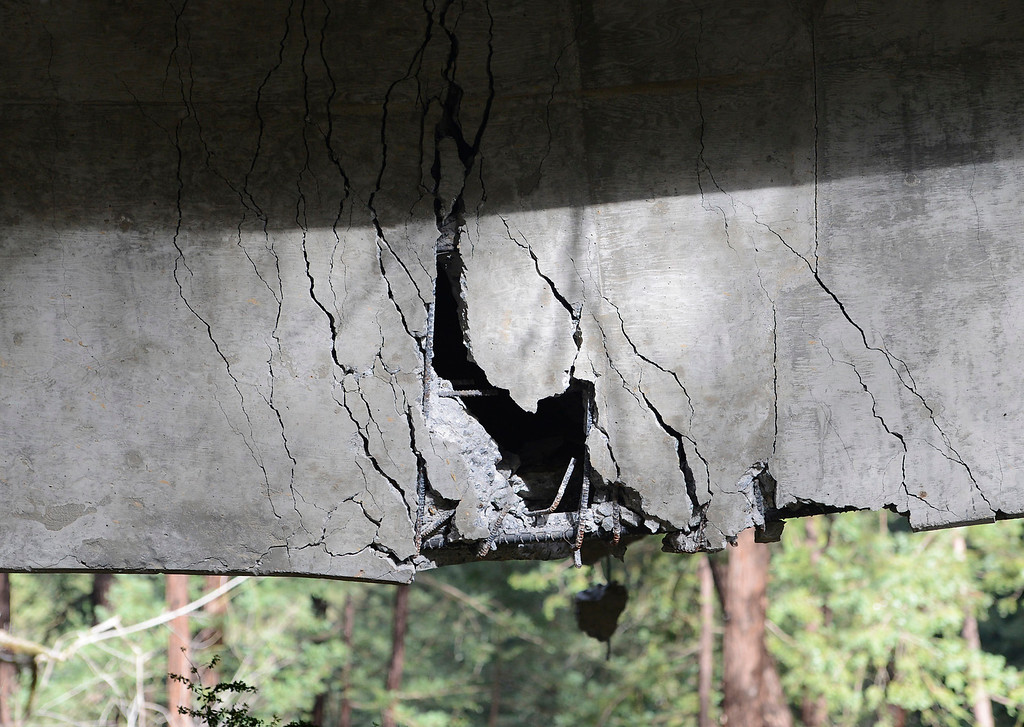 . Rebar is visible inside a large crack which sags down on the Pfeiffer Canyon Bridge on Highway 1 in Big Sur on Wednesday February 22, 2017. (David Royal - Monterey Herald)
