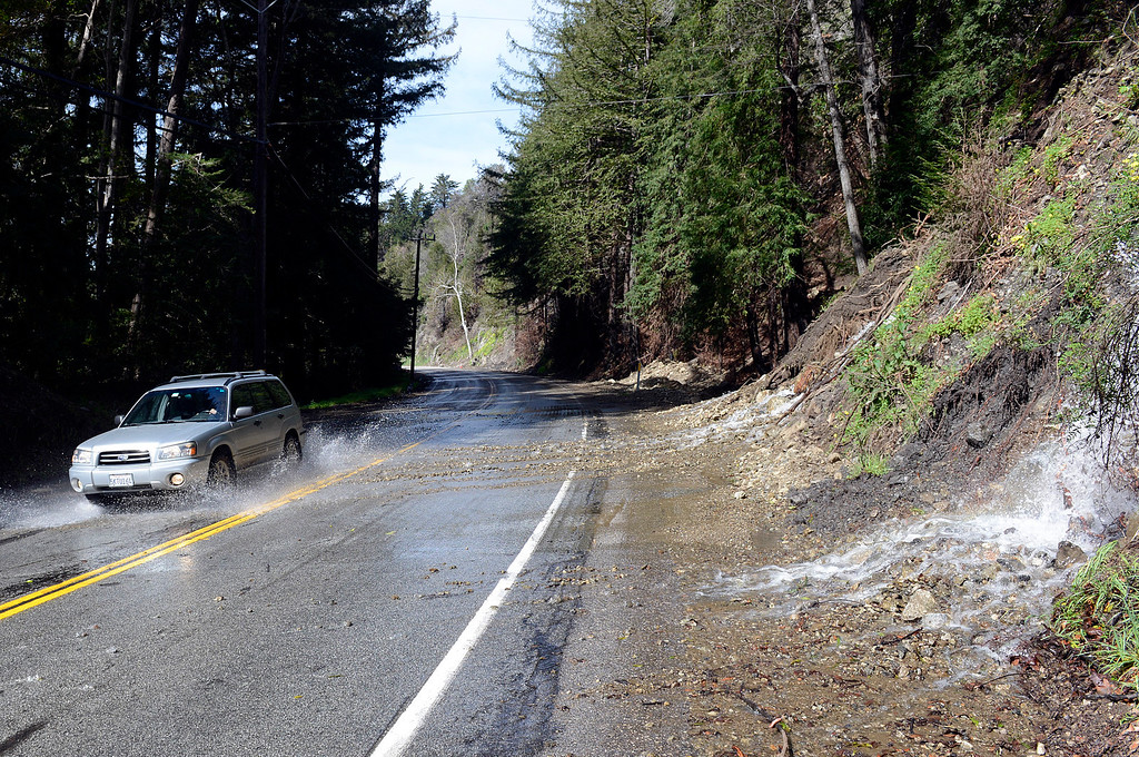 . A vehicle drive through heavy runoff in Big Sur Village on Wednesday February 22, 2017. (David Royal - Monterey Herald)