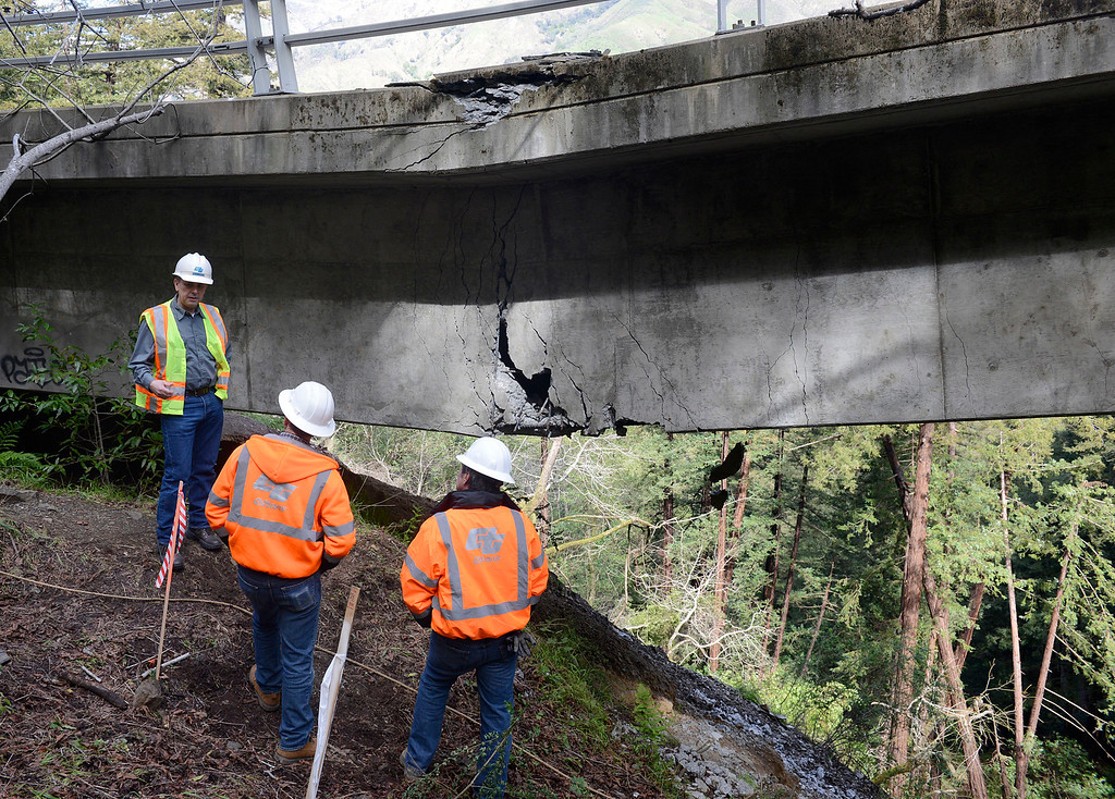 . Caltrans engineers evaluate storm damage near a large crack which sags down on the Pfeiffer Canyon Bridge on Highway 1 in Big Sur on Wednesday February 22, 2017. (David Royal - Monterey Herald)
