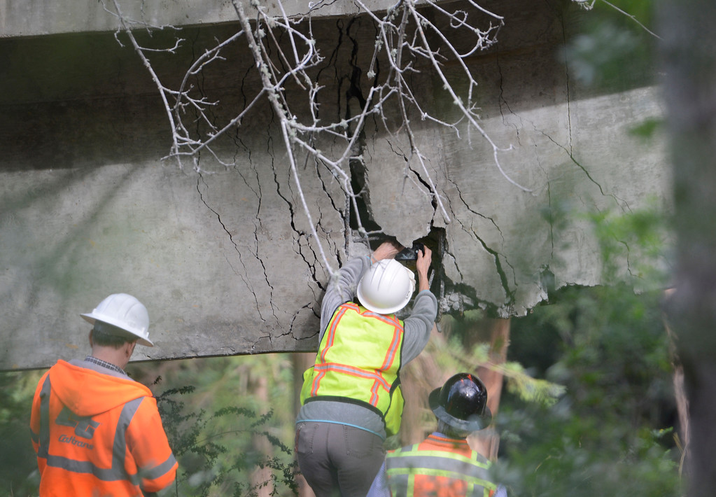 . A Caltrans engineer shoots a photo of the inside of a large crack on the Pfeiffer Canyon Bridge on Highway 1 in Big Sur on Wednesday February 22, 2017. (David Royal - Monterey Herald)