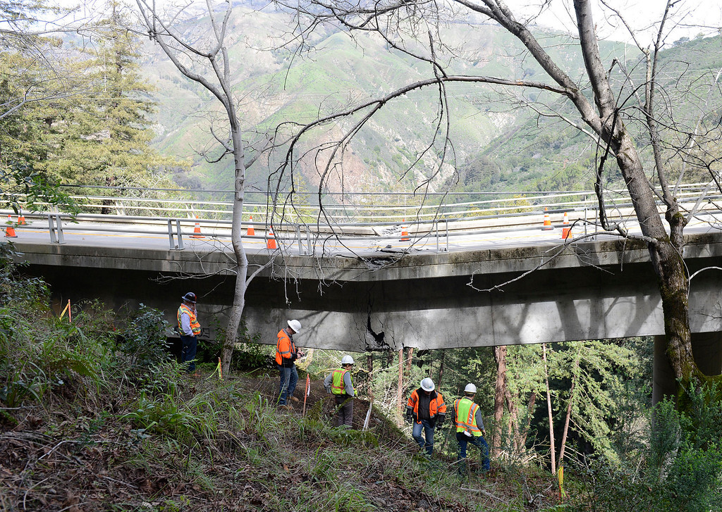 . Caltrans engineers evaluate storm damage near a large crack where the Pfeiffer Canyon Bridge is sagging on Highway 1 in Big Sur on Wednesday February 22, 2017. (David Royal - Monterey Herald)