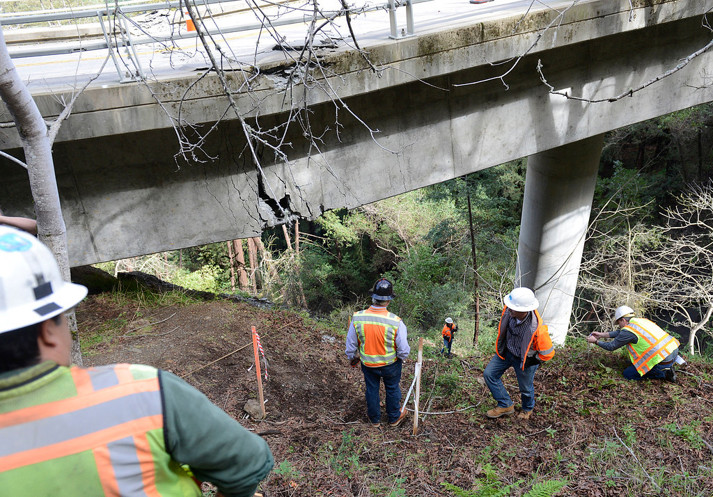 . Caltrans engineers evaluate storm damage near a large crack on the Pfeiffer Canyon Bridge on Highway 1 in Big Sur on Wednesday February 22, 2017. (David Royal - Monterey Herald)