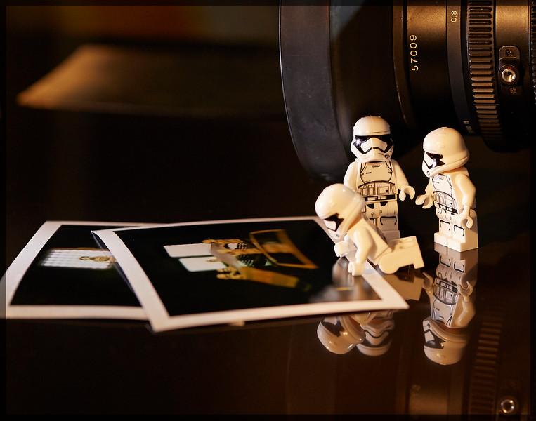 Checking Polaroids.