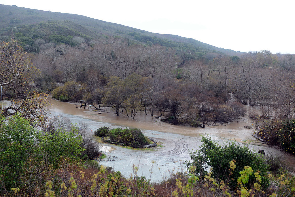 . The Big Sur River flows through the parking and day use area at Andrew Molera State Park in Big Sur on Monday January 9, 2017 after a large storm passed through Monterey County. (David Royal - Monterey Herald)
