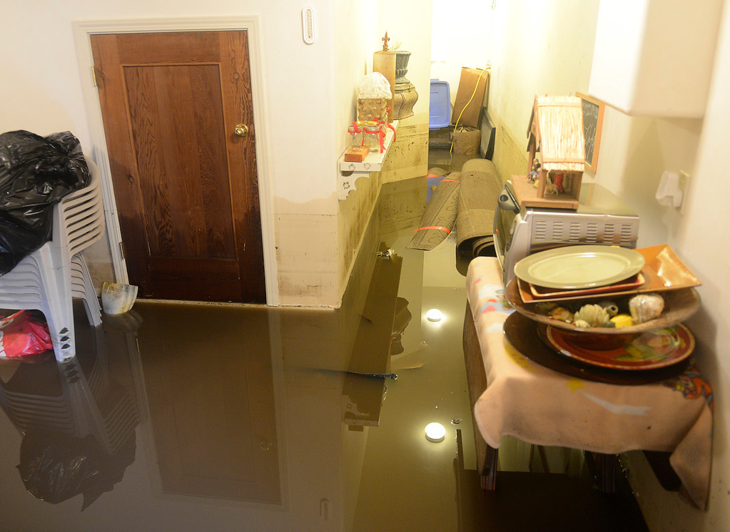 . A water mark on the wall of Joe Tringali\'s flooded home shows the height water reached after the Carmel River swept over its banks on Paso Hondo Road in Carmel Valley on Monday January 9, 2017 after a large storm passed through Monterey County. (David Royal - Monterey Herald)