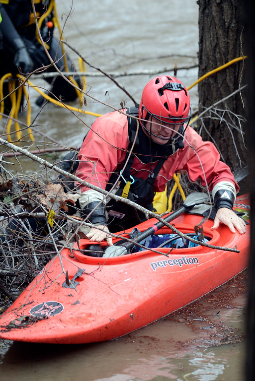. A kayaker pushes his boat to shore after his friend got snagged on trees while trying to kayak the Carmel River near Paso Hondo Road in Carmel Valley on Monday January 9, 2017 after a large storm passed through Monterey County. (David Royal - Monterey Herald)