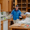 Mike Seidel, Weather Channel Meterologist, surveying damage inside kitchen of Devane house.