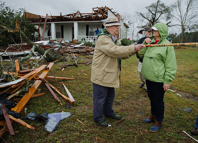 "Tobe Devane, age 87, grew up in this house. He is speaking with his niece, Van Devane Tucker, daughter of Kissum ""Kay""  and Betty Rowan Devane. Vanne and her husband, Leon Tucker, live just south of house; their brick home had roof damage, downed trees, and damage to out building."