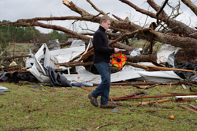University of North Carolina student taking measurements for the determination of the damage and catorization thereof. Leading the investigation were UNC professor/meteorologist, Christopher M. Godfrey, PhD, and UGA professor/forest ecologist, Chris J Peterson.  http://www.atms.unca.edu/cgodfrey/home.shtml
