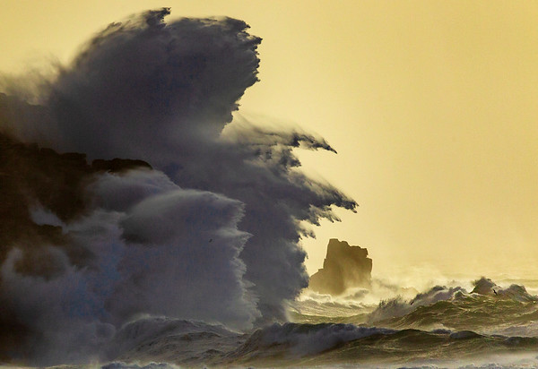 Massive waves strike the cliffs at Sennen during Storm Ciara, bursting over 200ft into the air.