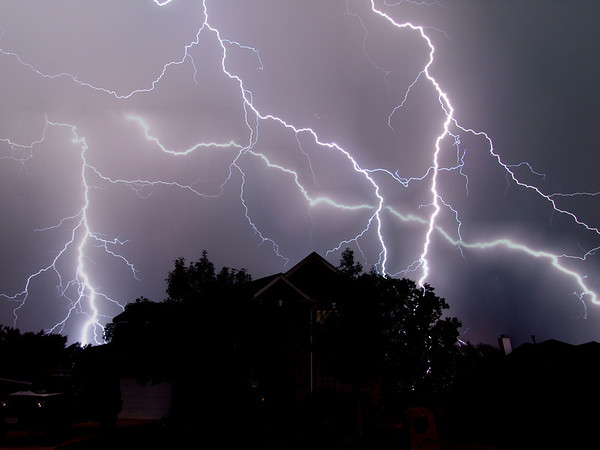 Many bolts of lightning behind house in Wylie
