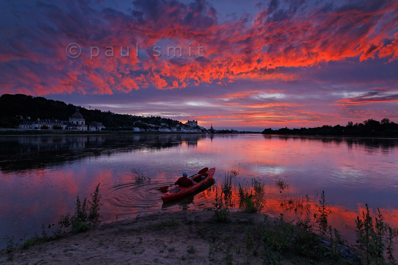 [FRANCE.LOIRE 10865]<br /> 'Evening sky above Saumur.'<br /> <br /> Admiring a wonderful evening sky above Saumur, a kayaker embarks on a late trip on the Loire. Photo Paul Smit.