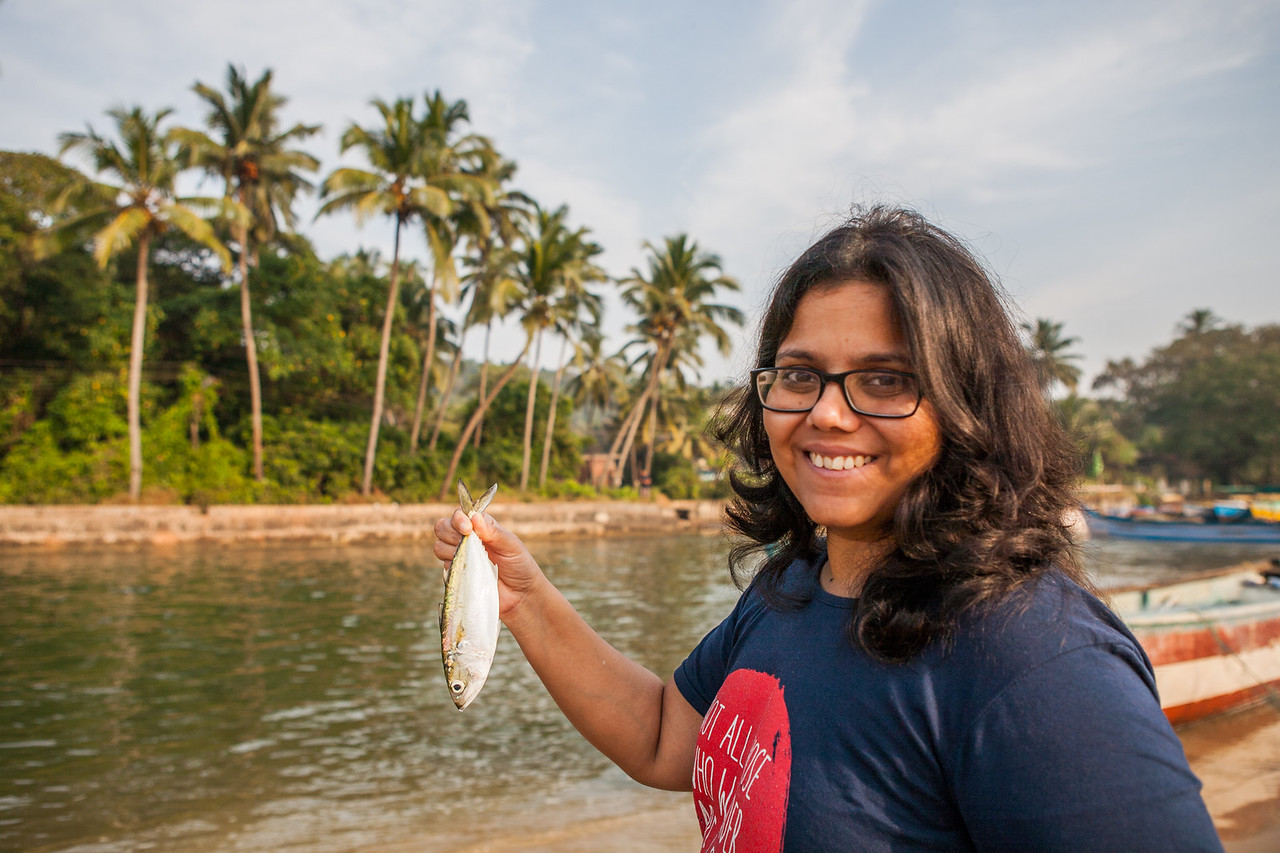 Sandeepa holding a mackerel at Baga beach in Goa
