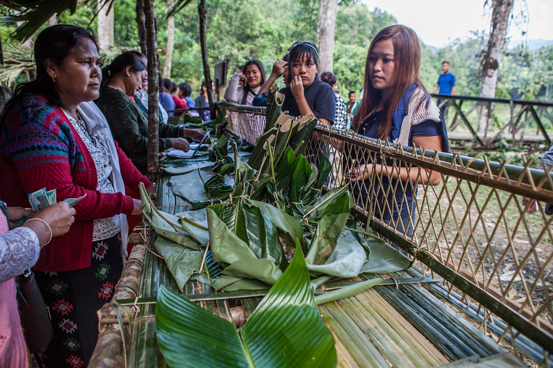 Food is served on leaf plates in food stalls built with bamboo at the Basar Confluence, BasCon, Basar, Arunachal Pradesh, India