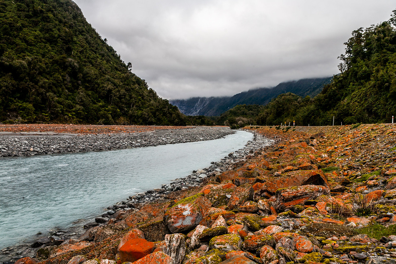 Red rocks on the river bed leading to Franz Josef glacier, New Zealand