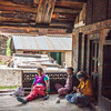 Women relaxing and knitting in an unused house of village Bagori in the Garhwal Himalayas of Uttrakhand