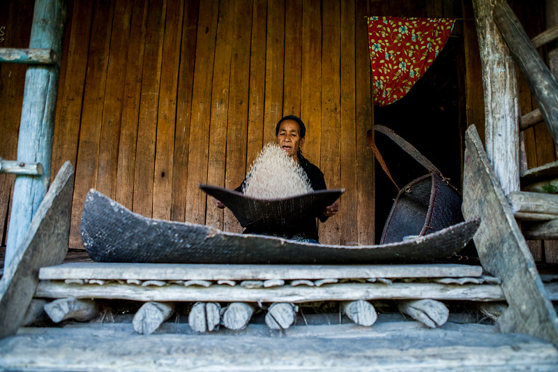 A woman busy with her afternoon chores in the Gori village of the district of Basar in Arunachal Pradesh, India.