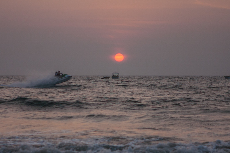 Water sports action in the waters at the backdrop of the setting sun in Goa