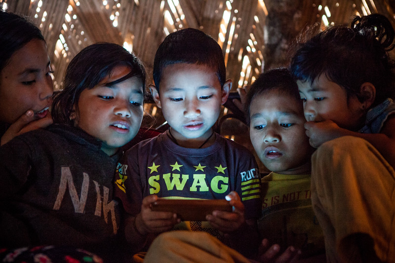 Kids playing games on mobile, Arunachal Pradesh, India