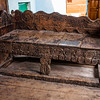 A carved wooden sofa in an unused house of village Bagori in the Garhwal Himalayas of Uttrakhand