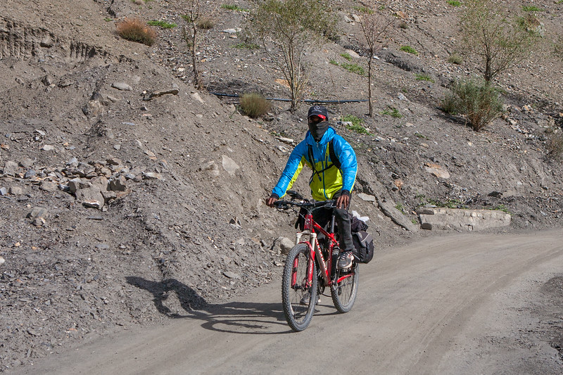 The cyclist at Gue, Spiti Valley, India