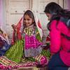 Girls weaving traditional designs in the village of Hodko in the Kutch region of Gujarat, India