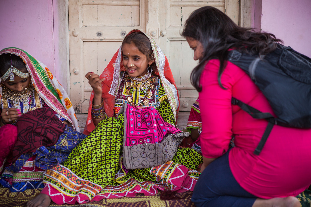 Girls weaving traditional designs in the village of Hodko in the Kutch region of Gujarat, India