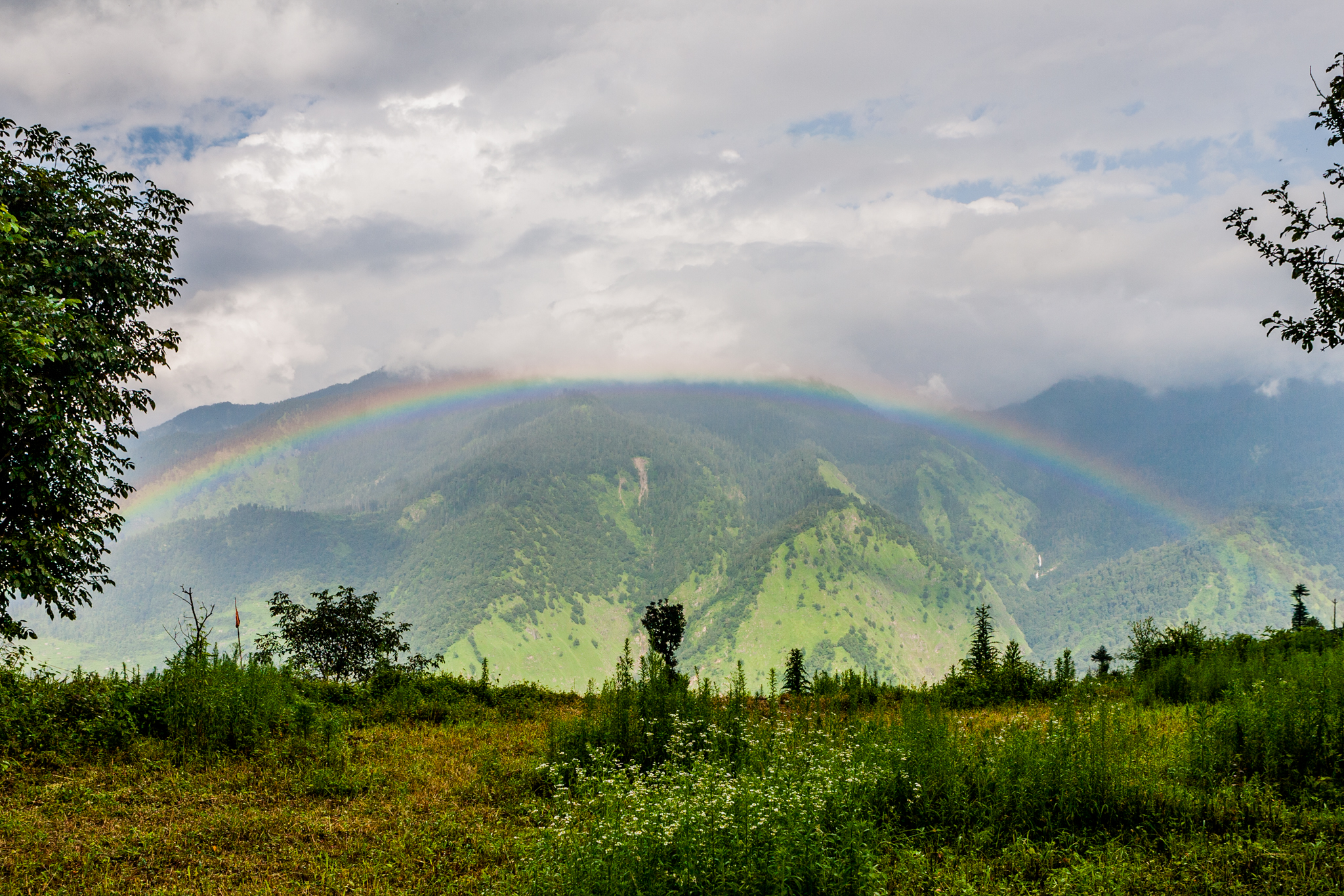 A rainbow greets us at The Goat Village, Raithal surrounded by the Himalayas