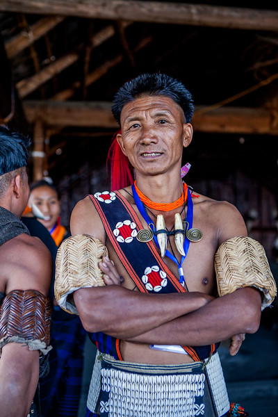 A Khiamniungam man poses in his morung at the Hornbill festival in Nagaland, India