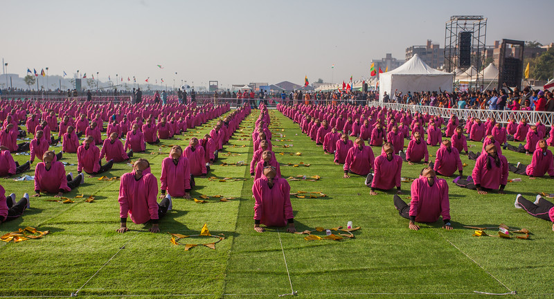Two thousand students of the Municipal school in Ahmedabad perform Suryanamaskar, salutation to the Sun at the International Kite Festival 2019, Ahmedabad, India