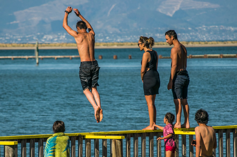 People of New Zealand having fun at the beach in Motueka in the South Island