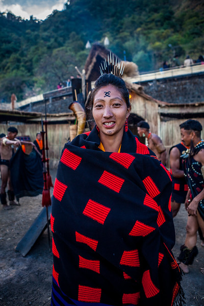 A Chang woman draped in the hand woven traditional shawl as it starts to get colder at the Hornbill Festival, Nagaland, India