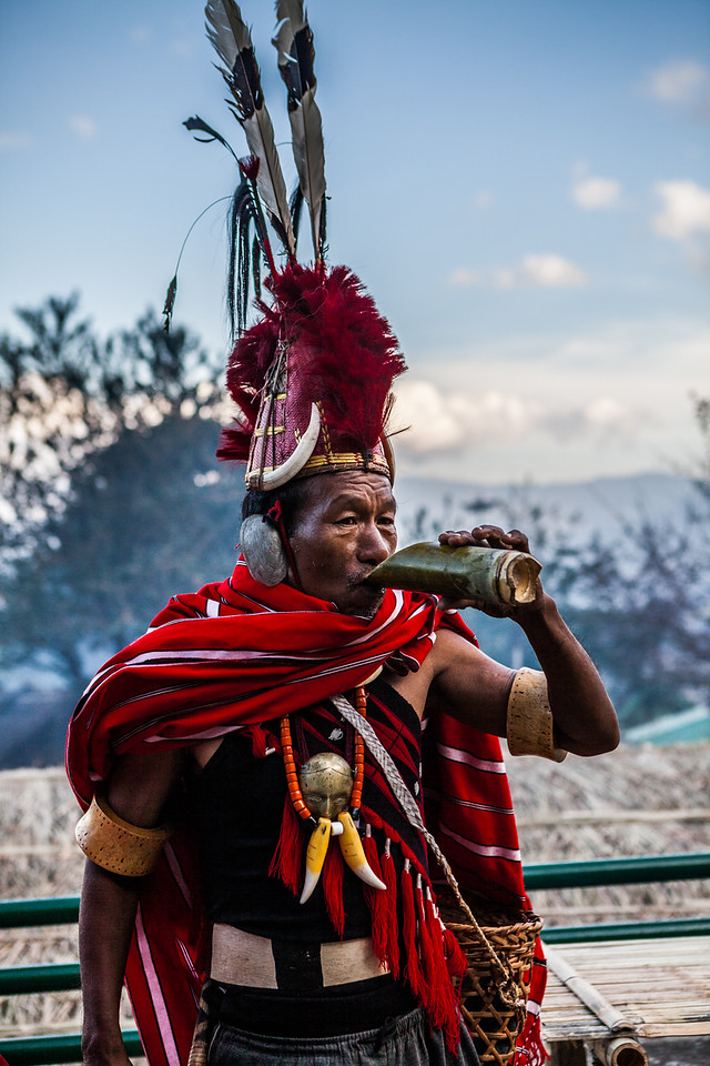 A member of the Konyak tribe takes a rice beer break at the Hornbill Festival, Nagaland, India