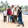 A group of young boys busy in taking a group selfie at Calangute beach in Goa