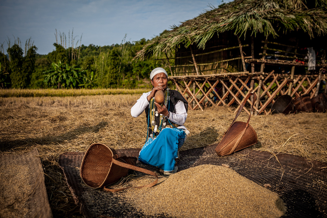 Galo woman drinking water during fieldwork, Basar, Arunachal Pradesh, India