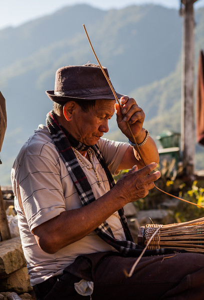 Man making lampshade using bamboo, Khonoma, Nagaland, India