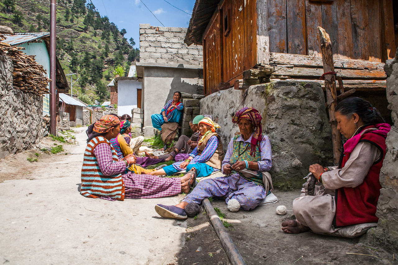 Women of the village Bagori in the Garhwal Himalayas of Uttarakhand busy in knitting in late summer