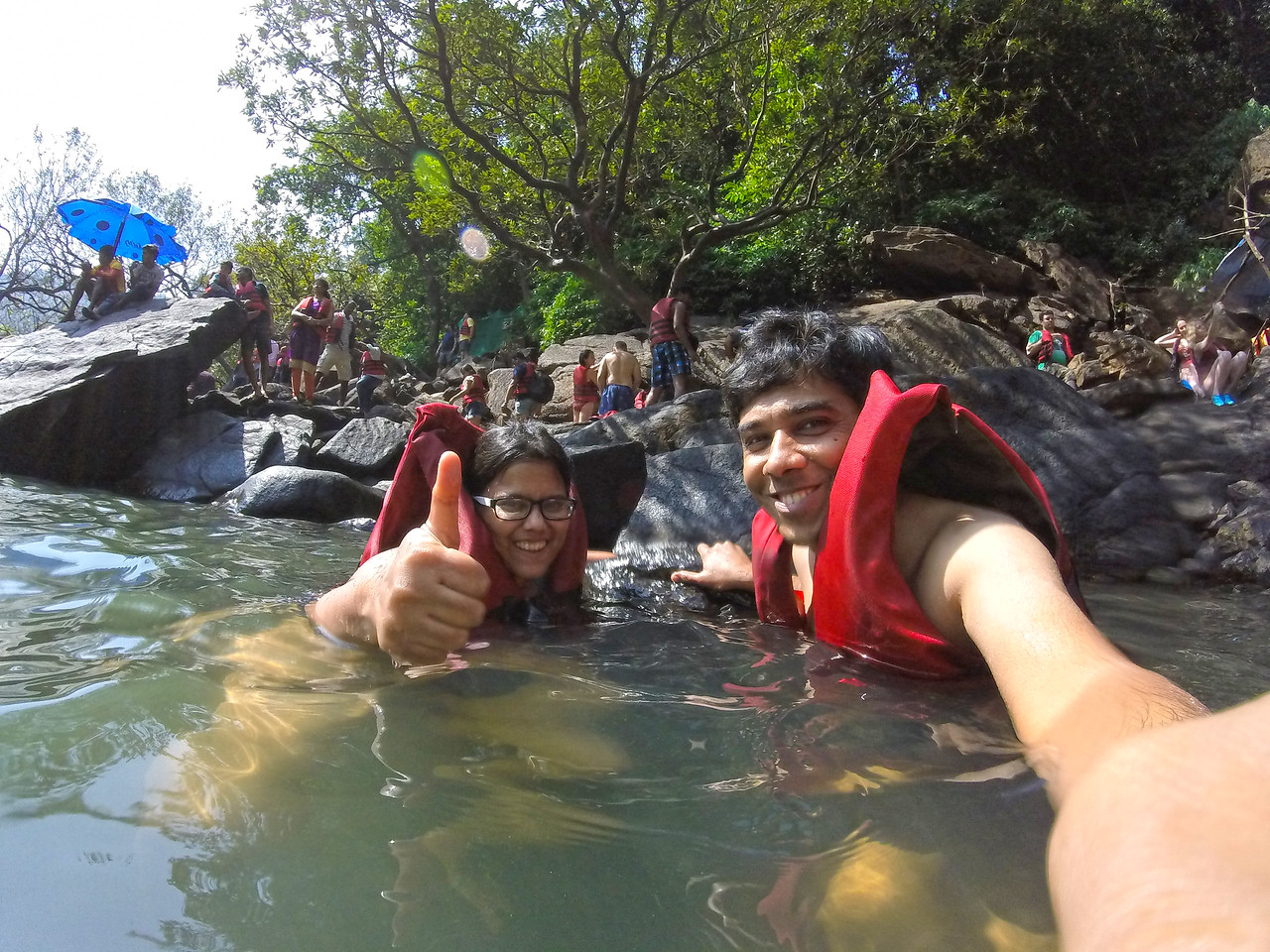 Sandeepa and Chetan swimming in the waters of the Dudhsagar waterfalls, Goa