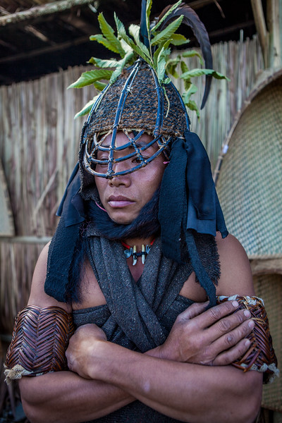 The Khiamniungam man stands still observing the visitors to his morungs at the Hornbill festival in Nagaland, India