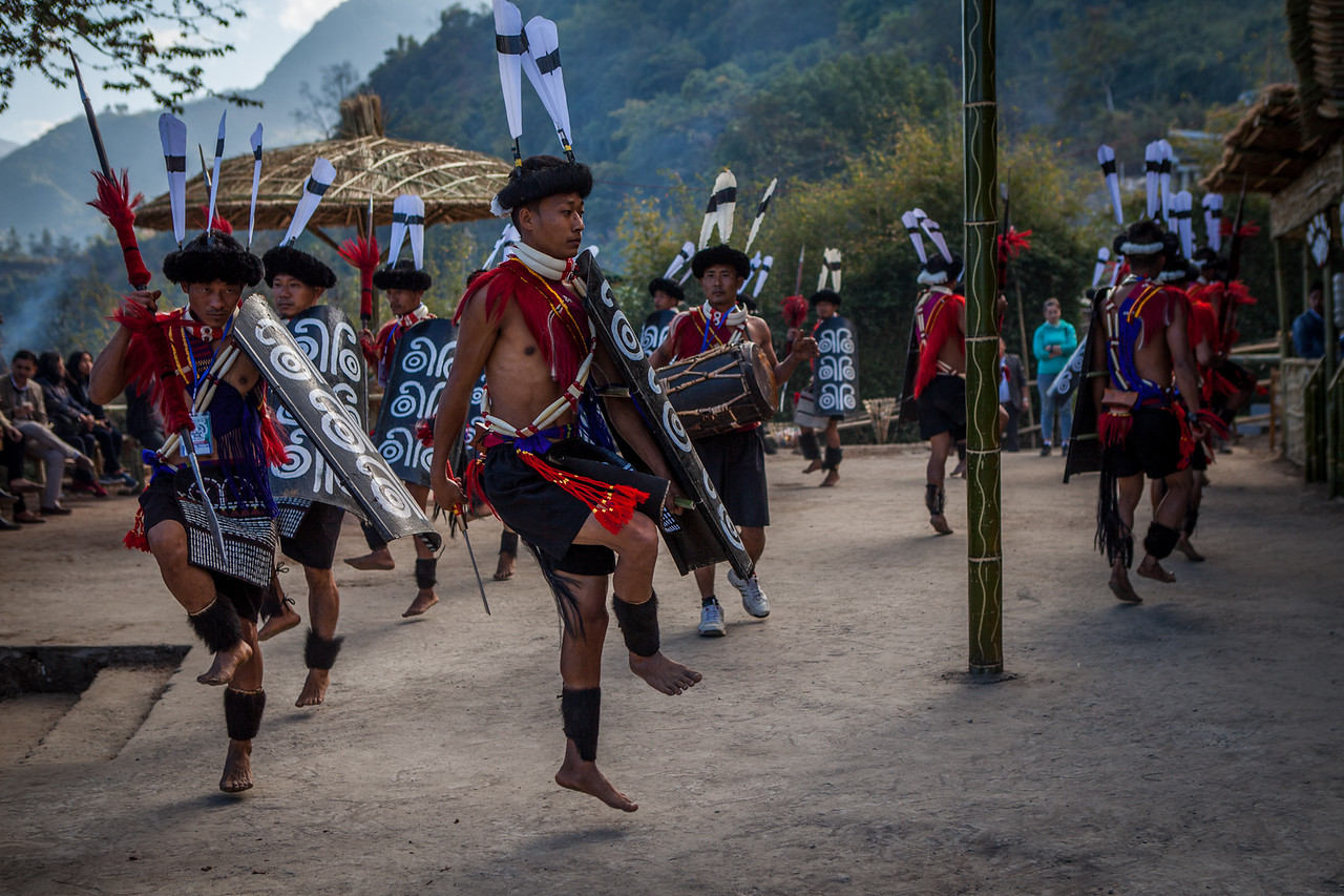 Performers of the Ao tribe practice outside their Morung at the Hornbill festival in Nagaland, India