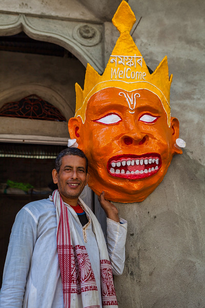 Mask maker displaying his creation in the Chamaguri Satra on the island of Majuli, Assam, India.
