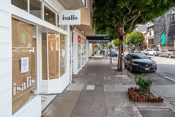 A very quiet day on Union Street facing West.  To the left, shops like Isalis indicates its Instagram handle for those interested in getting updates.